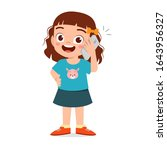 Happy Cute Little Kid Girl Use...