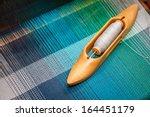 Weaving Shuttle On The Warp
