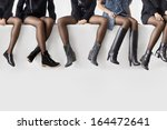 woman's legs in different shoes | Shutterstock . vector #164472641