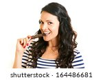 young woman eating chocolate | Shutterstock . vector #164486681