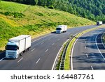 highway with three oncoming... | Shutterstock . vector #164487761