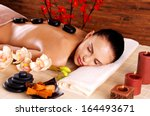 adult woman relaxing in spa... | Shutterstock . vector #164493671