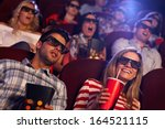 young people sitting at cinema  ... | Shutterstock . vector #164521115