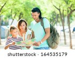 happy couple with teenage child ... | Shutterstock . vector #164535179