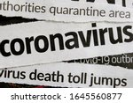 Novel coronavirus breaking news headline clippings from various newspapers reporting on the deadly disease, macro view. Concept for global coverage on severity of Covid-19 or 2019-ncov virus.