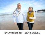 Cheerful Senior People Walking...