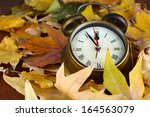 Old Clock On Autumn Leaves...