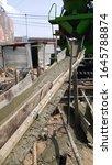 Wooden concrete chute.Concrete delivering by chute.