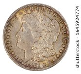 1901 Lady Liberty silver dollar with patina.