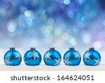 christmas balls on a holiday... | Shutterstock . vector #164624051