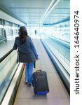 woman traveling with luggage | Shutterstock . vector #164640974