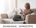 Modern Arabic Girl Sitting On...