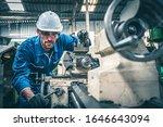 Male Worker In Blue Jumpsuit...