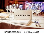 Reserved Sign On A Table In...