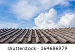 Old Roof With Blue Sky And...