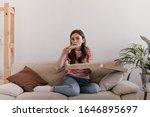Model Sits On Soft Bright Sofa...