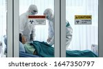 Small photo of coronavirus covid 19 infected patient in quarantine room with quarantine and outbreak alert sign at hospital with coronavirus covid 19 disease control experts make coronavirus disease treatment