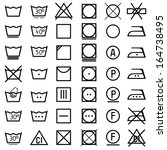 set of vector icons on clothing ... | Shutterstock .eps vector #164738495
