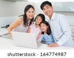 portrait of a happy family of... | Shutterstock . vector #164774987