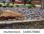 Landscaped garden with decorative stones, rocks and plants