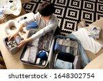 Female Hands Packing Traveler...