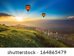 sunset over forest mountain... | Shutterstock . vector #164865479