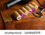 wine corks with corkscrew on... | Shutterstock . vector #164868509