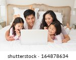 happy relaxed family of four... | Shutterstock . vector #164878634
