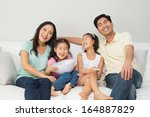 portrait of a happy family of... | Shutterstock . vector #164887829