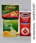 Small photo of Boxes of medicine for flu and cold relief isolated. Tesco cold and flu sachets, Benylin chesty cough and Lemsip max. Edinburgh Scotland UK. February 2020