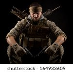 Soldier with two guns