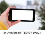 female hands holding a phone...   Shutterstock . vector #1649419024