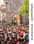 Small photo of KERALA, INDIA - MAY 13, 2019: Huge crowd of people, tourist enjoying watching Thrissur Pooram festival or Puram, parade in Hindu temple with many decorated elephants with gold caparison, red umbrella.