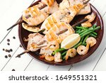 Small photo of Grilled squid or calamari on skewer.Barbecue squids on a plate.