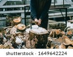 Man Is Chopping Wood With...