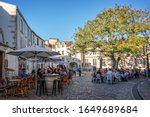 Small photo of LA ROCHELLE, FRANCE - MAY 31: Tourists eating outdoor at restaurants terraces in summer in a picturesque square of the old town, on May 31, 2019 in La Rochelle, France