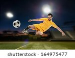 soccer player kicking the ball... | Shutterstock . vector #164975477