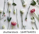 fresh flowers on white wood... | Shutterstock . vector #1649764051