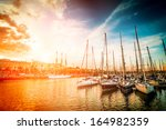 Sea Bay With Yachts At Sunset