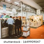 Small photo of Strasbourg, France - Feb 16, 2020: Adult friedns buy French wine at the Vignerons independant English: Independent winemakers of France wine fair for private and horeca customers