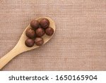 Macadamia Nuts In A Wooden...