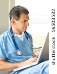 doctor in blue scrubs sitting... | Shutterstock . vector #16503532