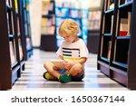 Child In School Library. Kids...