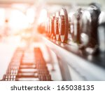 rows of dumbbells in the gym | Shutterstock . vector #165038135
