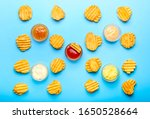 tasty potato chips and sauces... | Shutterstock . vector #1650528664