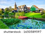 Summer village river house view. River village scene. Summer rural river village. Village river houses