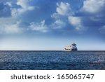 cargo ship in the ocean in the... | Shutterstock . vector #165065747