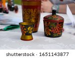 A Wooden Painted Glass And A...