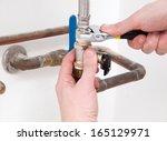 hands repairing the plumbing... | Shutterstock . vector #165129971