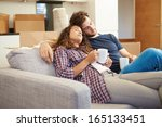 tired couple relaxing on sofa... | Shutterstock . vector #165133451